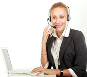 Female call center operator with headphone Royalty Free Stock Photo