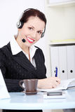Female call centre employee in headset Stock Image