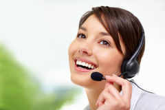 Female call centre employee speaking on  headset Royalty Free Stock Photos
