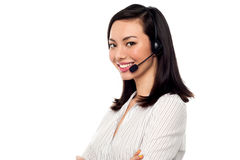 Female call centre executive. Young confident call centre executive at your assistance Stock Photos