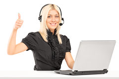 Female call service operator giving a thumb up Stock Photography