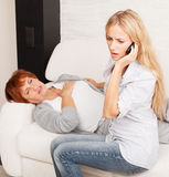Female calling 911. Cardiac pain Stock Images