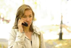 Female calling by phone Royalty Free Stock Photography