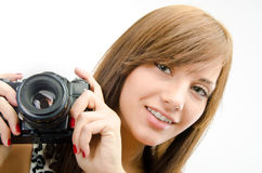 Female with camera. Portrait of woman using reflex digital camera Stock Photos