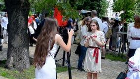 Female with camera, Embroidery dress Vyshyvanka parade in Kiev, Ukrain stock video