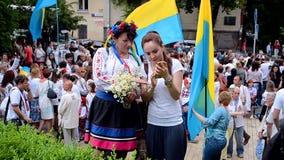 Female with camera, Embroidery dress Vyshyvanka parade in Kiev, Ukrain stock video footage