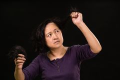 Female cancer patient with hair falling out Stock Photos