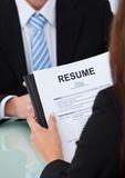 Female candidate holding resume at desk Stock Photos