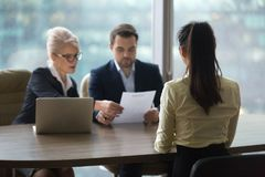 Female candidate interview with HR managers in office stock photography