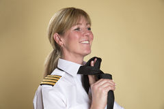 Female captain tying uniform tie Royalty Free Stock Photography