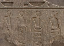 Female captives roped together, Temple of Luxor, Egypt stock photography