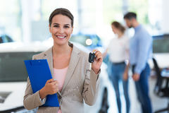 Female car dealer in showroom Stock Photo
