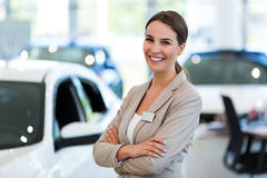 Female car dealer in showroom Stock Images