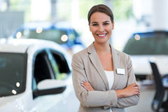 Female car dealer in showroom Royalty Free Stock Photography