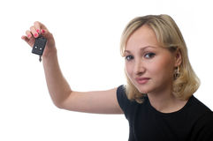 Female with car keys. The smiling girl keeps car keys, is isolated, a white background Royalty Free Stock Photos