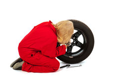 Female car mechanic with wheel stock images