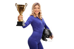 Female car racing champion holding trophy. Female car racing champion holding a gold trophy and showing it towards the camera isolated on white background royalty free stock photography