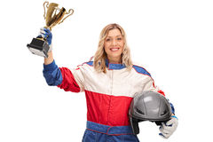 Female car racing champion holding a trophy Royalty Free Stock Photo