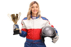 Female car racing champion holding a trophy. Young female car racing champion holding a gold trophy and looking at the camera isolated on white background Royalty Free Stock Image