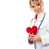 Female cardiologist with red heart. Royalty Free Stock Photos