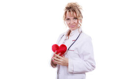 Female cardiologist with red heart. Periodic examinations. Cardiology concept. Female cardiologist holding red heart. Middle aged doctor with stethoscope and royalty free stock photo