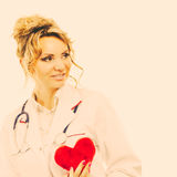 Female cardiologist with red heart. Stock Image