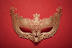 Female carnival golden mask on red background. Royalty Free Stock Photo