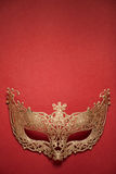 Female carnival golden mask on red background. Stock Photos