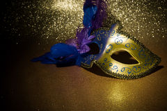 Female carnival mask. Over gold background stock photography