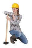 Female carpenter. Posing with hammer Royalty Free Stock Images