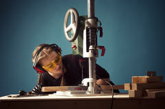 Female carpenter and drilling machine. Stock Photography