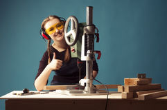 Female carpenter and drilling machine. Stock Images