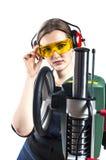 Female carpenter and drilling machine. Stock Image