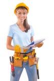 Female carpenter holding clipboard Stock Images