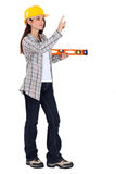 Female carpenter with ruler Stock Photo