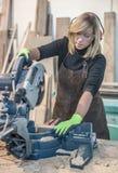 Female carpenter Using Circular Saw. For wood Royalty Free Stock Photo