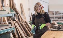 Female carpenter Using Electric Sander Royalty Free Stock Photo