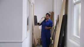 Female Carpenter At Work. Female carpenter is carrying her equipment stock video