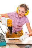 Female carpenter  at work using hand drilling machine. A Female carpenter  at work using hand drilling machine Royalty Free Stock Photos