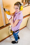 Female carpenter  at work using hand drilling machine Stock Photography