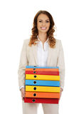 Female carrying heavy binders against. Stock Photos