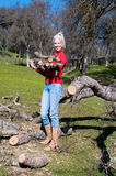 Female Carrying Oak Logs Stock Photos