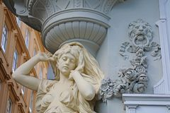 Female caryatid detail with a decorative pillar and ornamental reliefs. Detail at Jugendstil house in the Graben street in the. Center of Vienna, Austria royalty free stock photos