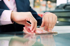 Female cashier counting money Royalty Free Stock Photo