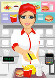 Female cashier at fast food restaurant returning a credit card Stock Photo