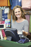 Female Cashier At Sales Desk With Credit Card Machine Stock Images
