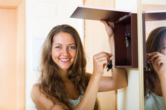 Female in casual holding appartment keys indoor Stock Photography
