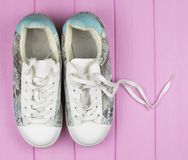 Female casual sneakers of white and turquoise color royalty free stock images
