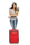 Female in casual standing with travel suitcase Stock Photography