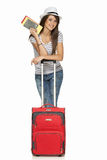 Female in casual standing with travel suitcase. Full length of young female in casual standing with travel suitcase, holding passport and tickets, isolated on Royalty Free Stock Photos